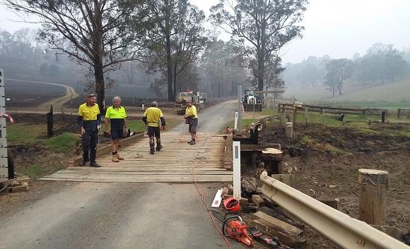 The bridge crew work to repair the damaged bridge