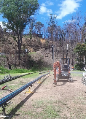 Long lengths of large poly pipe is laid out