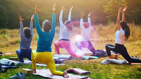 A group of people doing a yoga outside