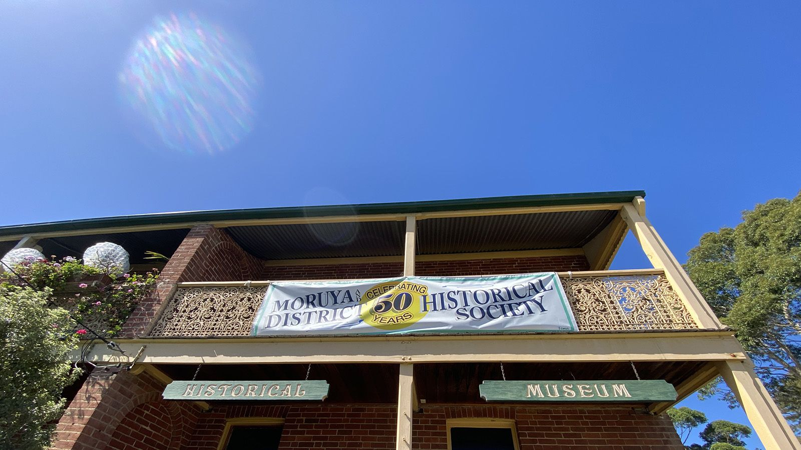 The external facade of the Moruya Museum with a banner titled Moruya Historical Society banner image