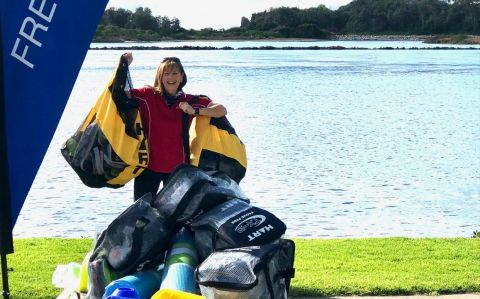 Donna McLean in front of the Narooma estuary with sports equipment