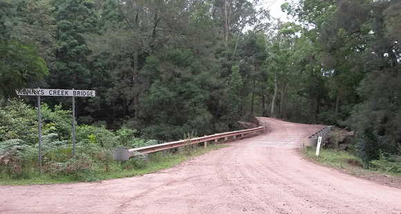 The timber bridge sits in a green setting
