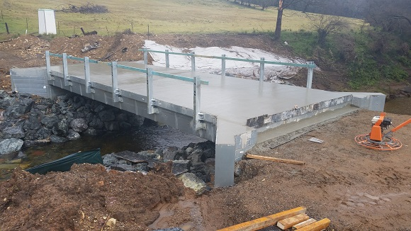 Freshly poured concrete forms the new bridge surface