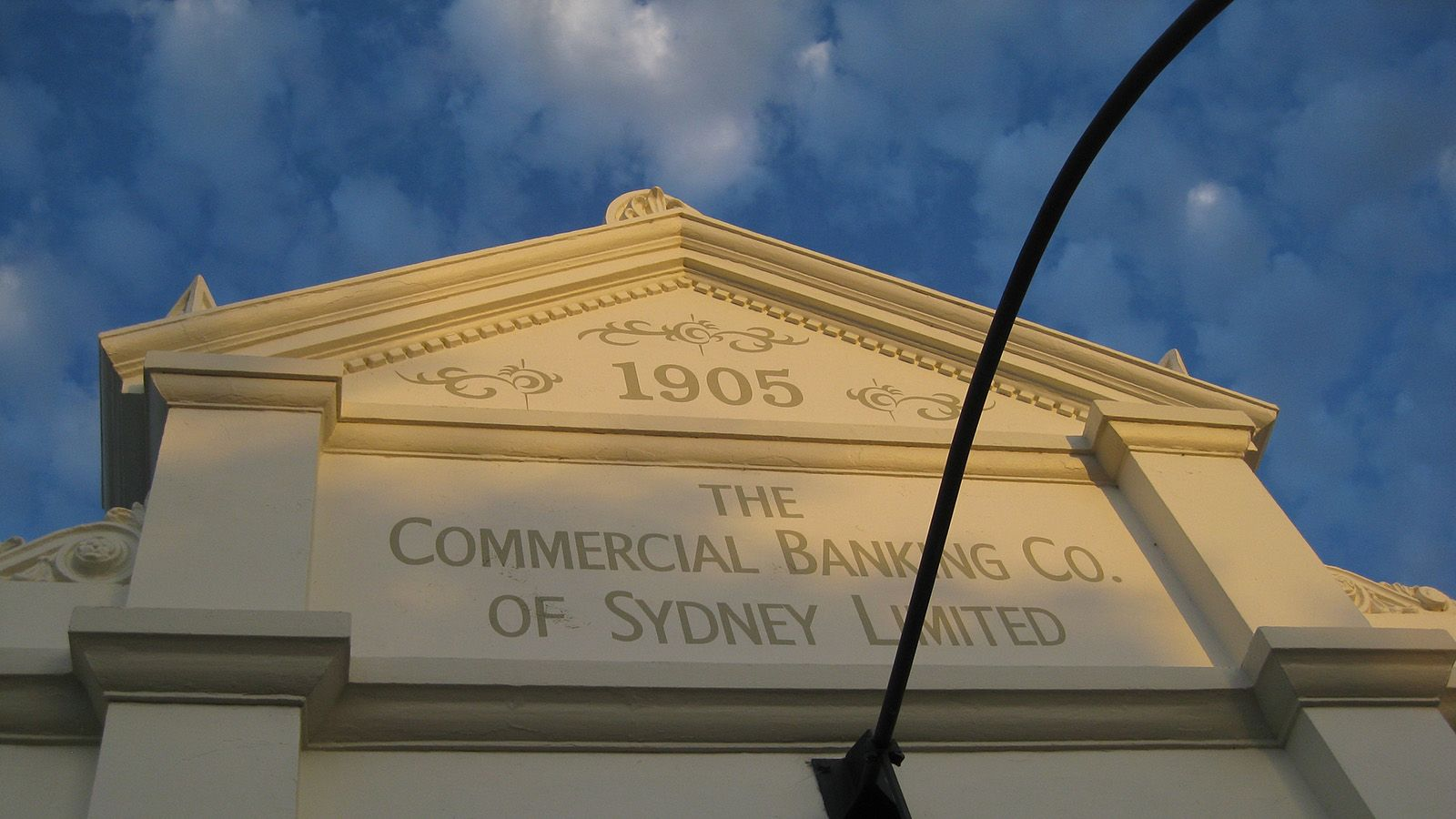 Cropped photograph of the facade of the Commercial Banking Co of Sydney Limited heritage building banner image