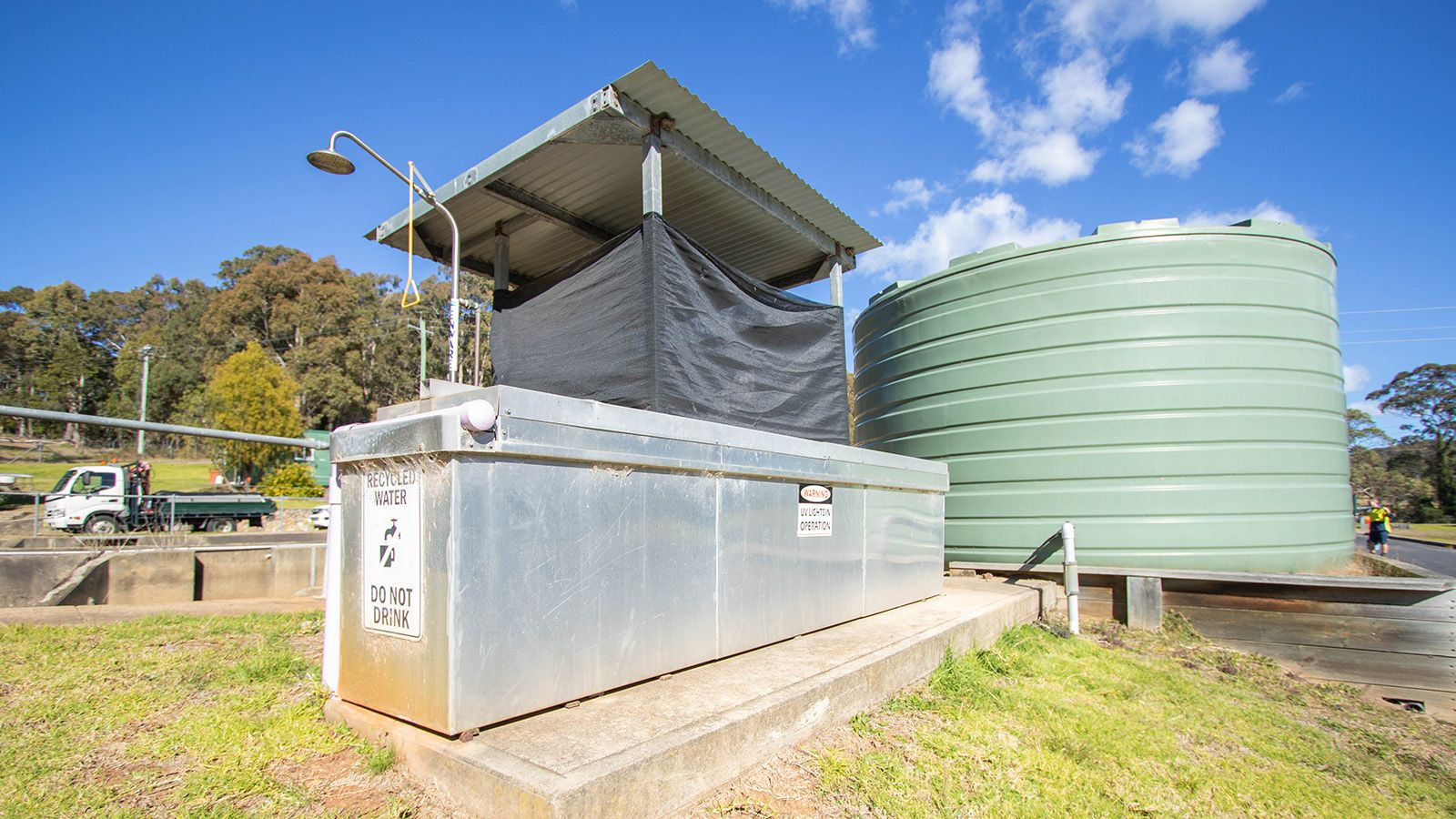 Recycled water container and large tank at a Eurobodalla Council sewer treatment facility banner image
