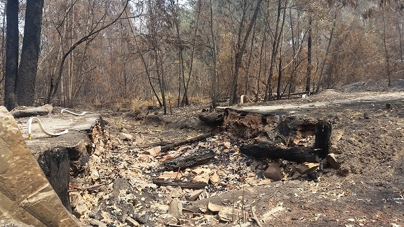 A large hole and few charred remains are what the fire left behind