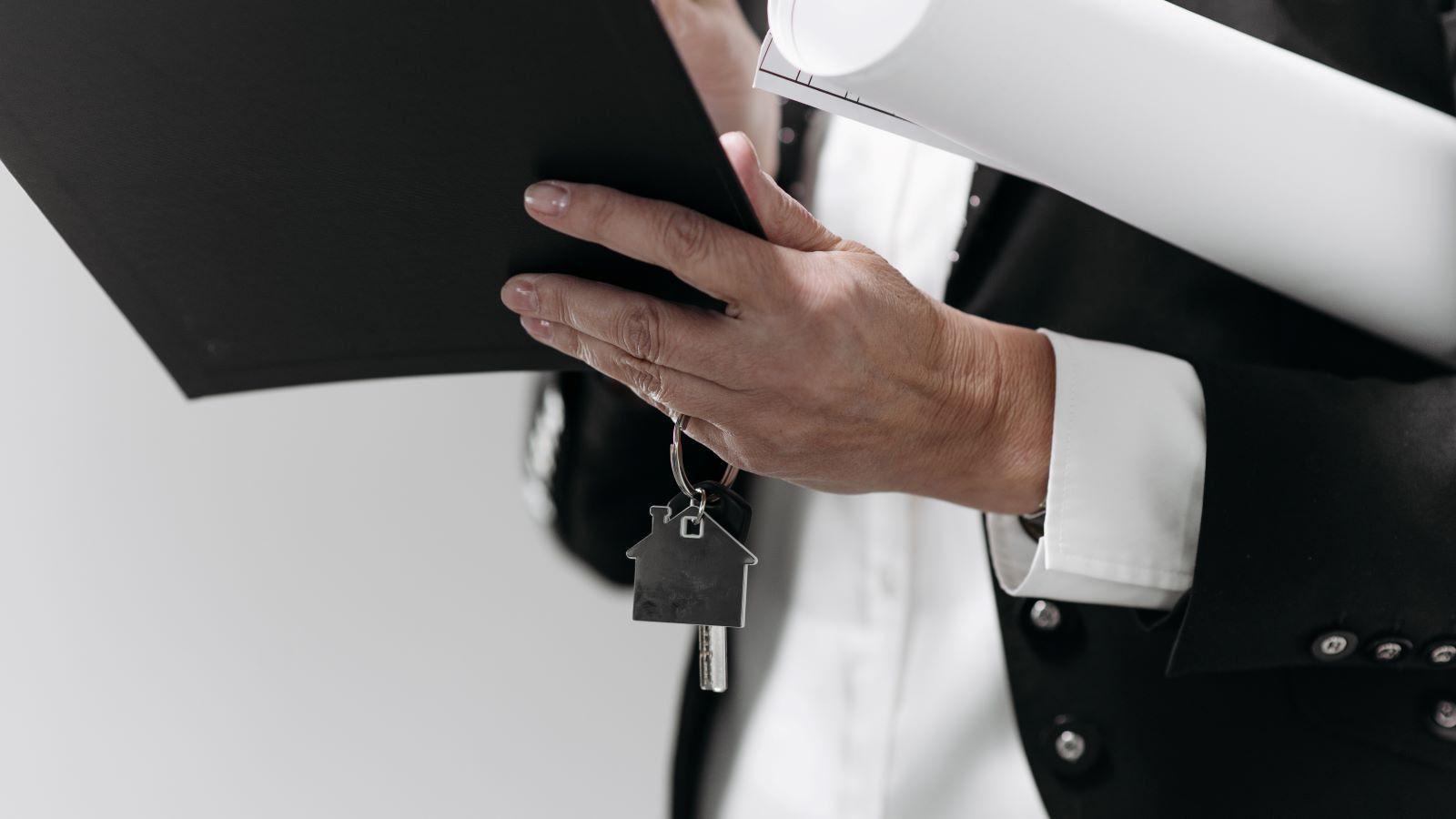 Modern wood panel house against blue sky banner image