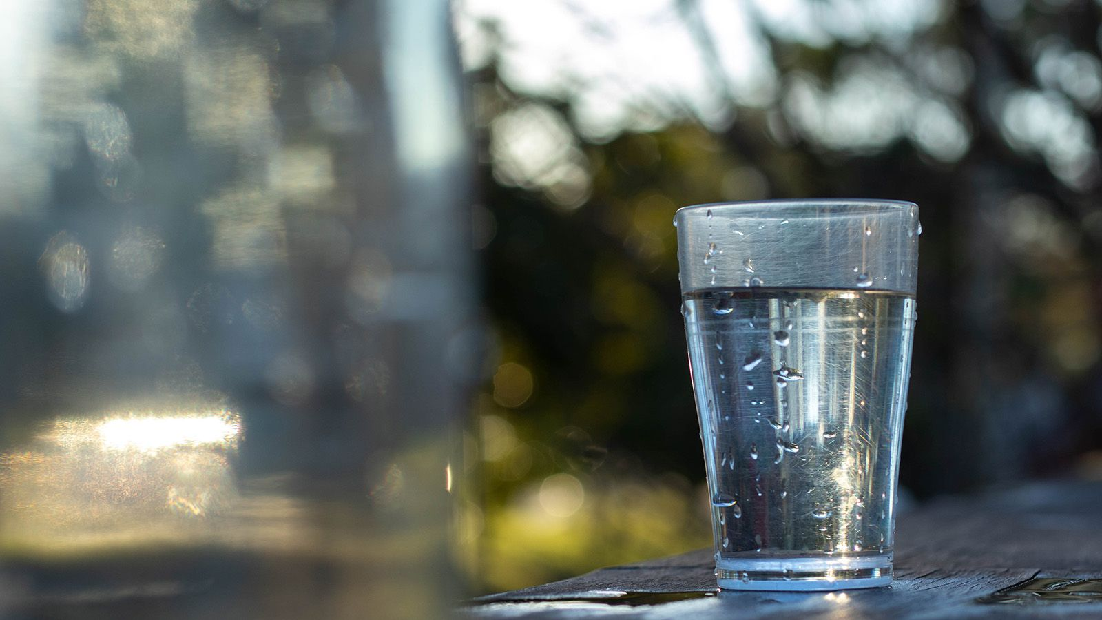 A drinking glass filled with water banner image