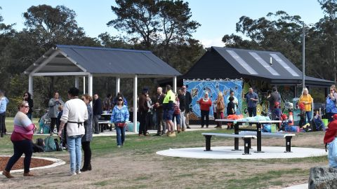 Crowd enjoying playground and facilities at Mogo Recreation Park
