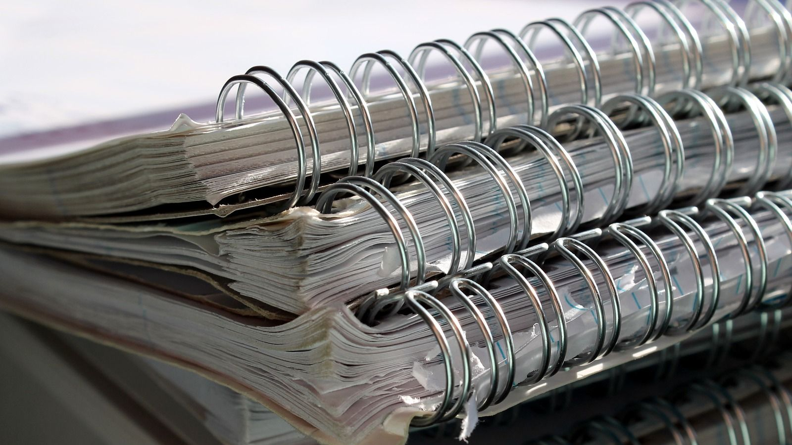 Stack of spiral notebooks on top of each other  banner image