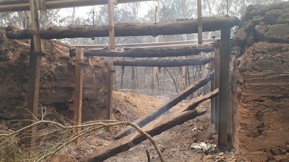 A deep hole is all that is left after the fire passed through