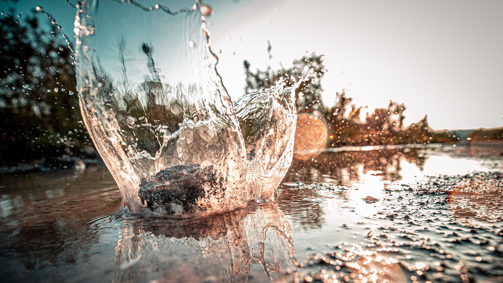 Water splash in a shallow river banner image