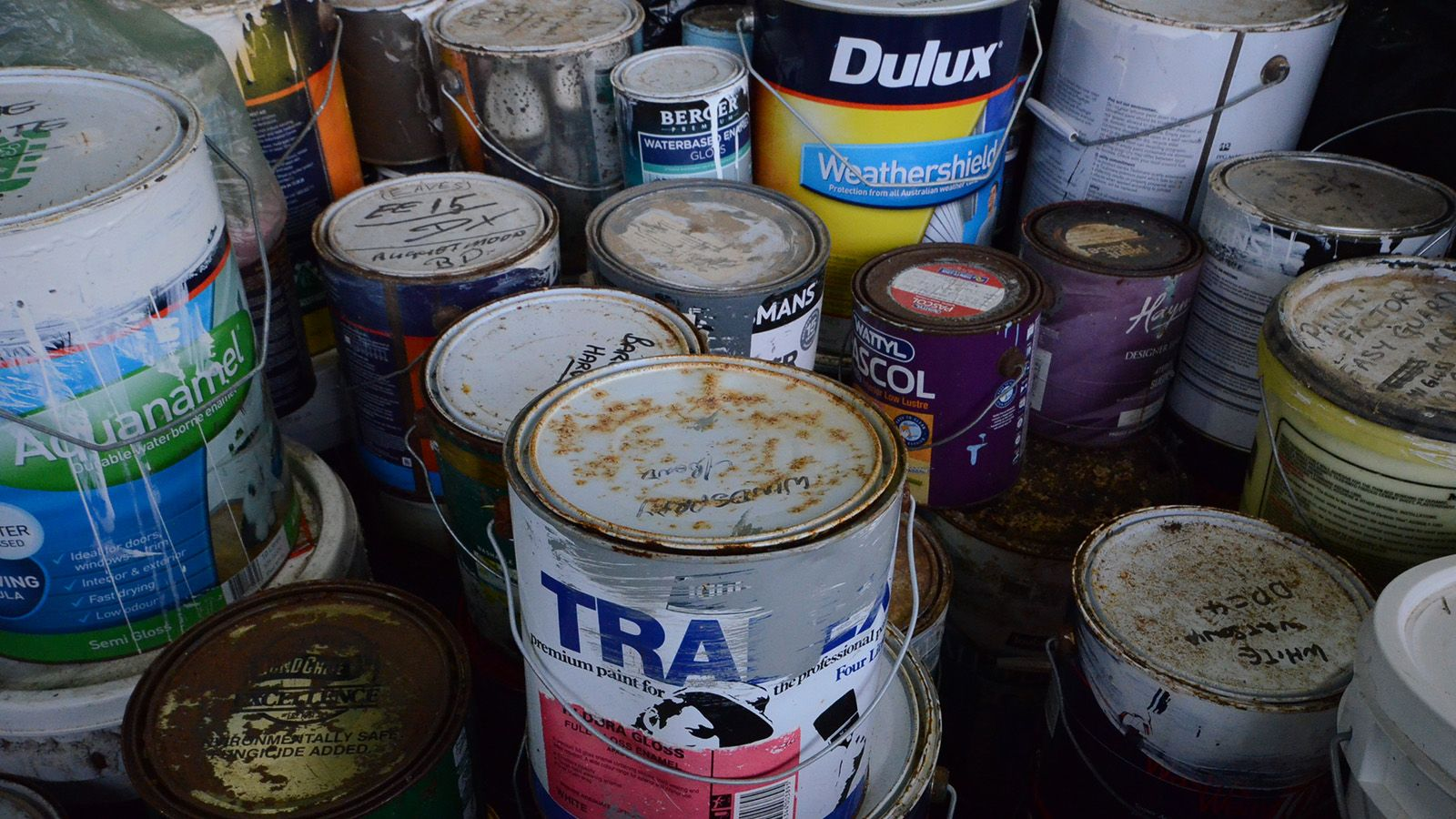 Old paint tins and chemical containers banner image