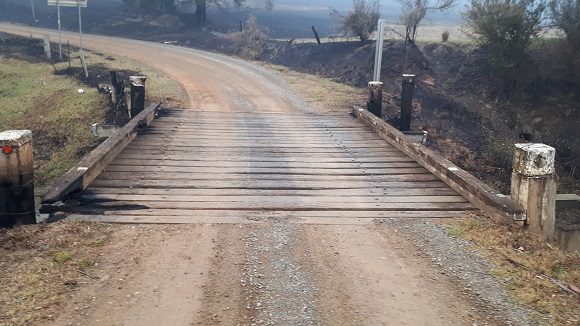 The timber bridge has relatively small burnt areas