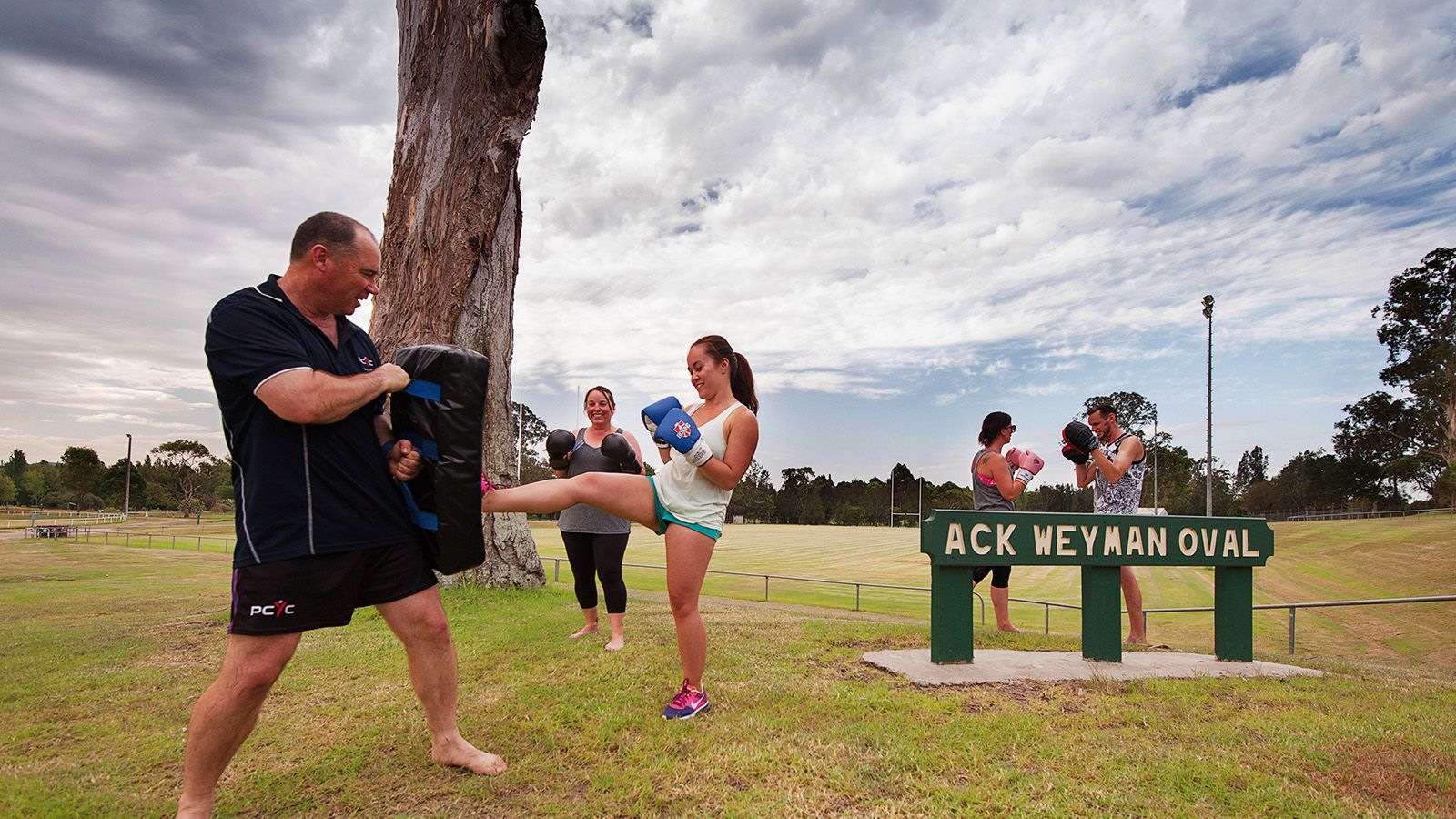 Five people participating in a boxing training session at Moruya's Ack Weyman Oval banner image