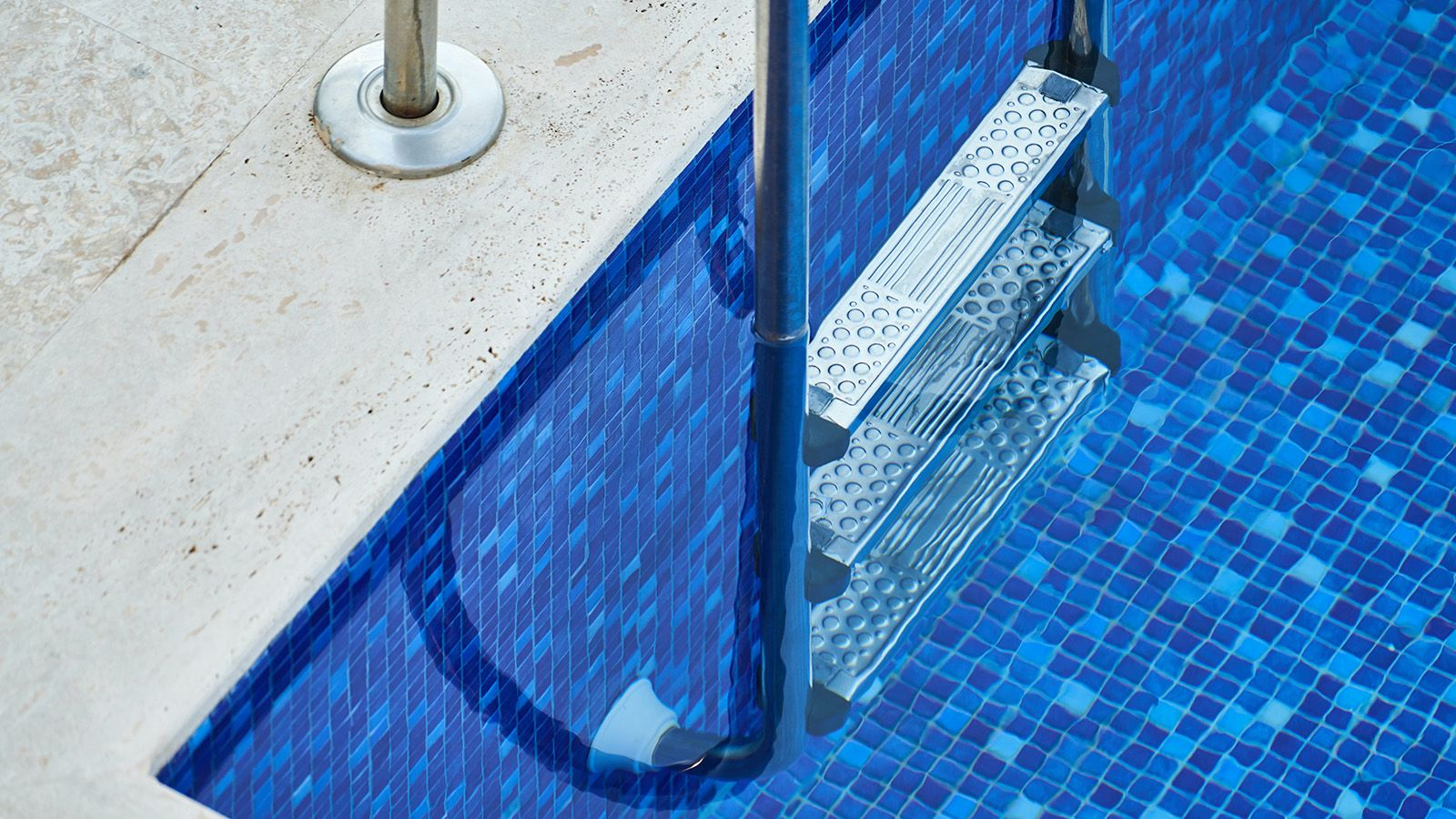 Close cropped photograph of a swimming pool ladder banner image