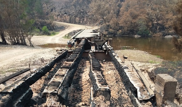 The bridge is severely burnt and not much remains