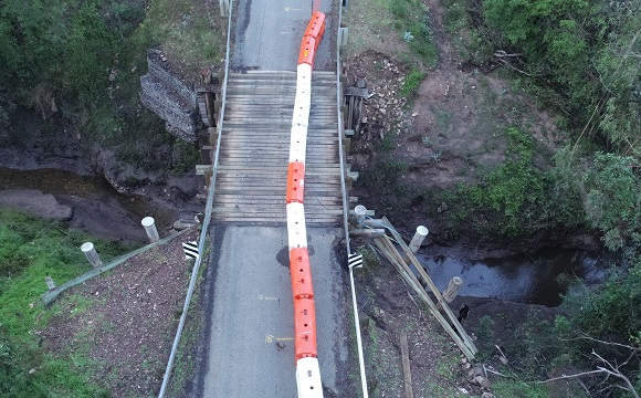 A drone photo shows damage caused to the abutments on one sides of the bridge