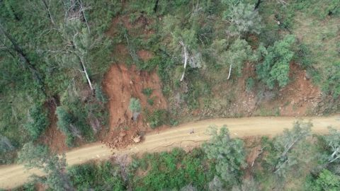 Aerial view of rubble on a cracked road