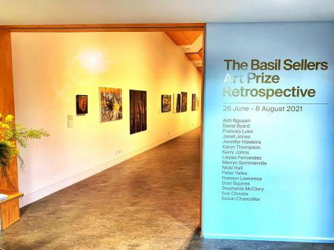 Sign of past winners and view in to Basil Sellers Art Prize retrospective