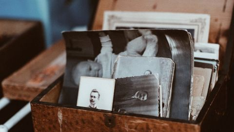 Black and white photographs in an open wooden box