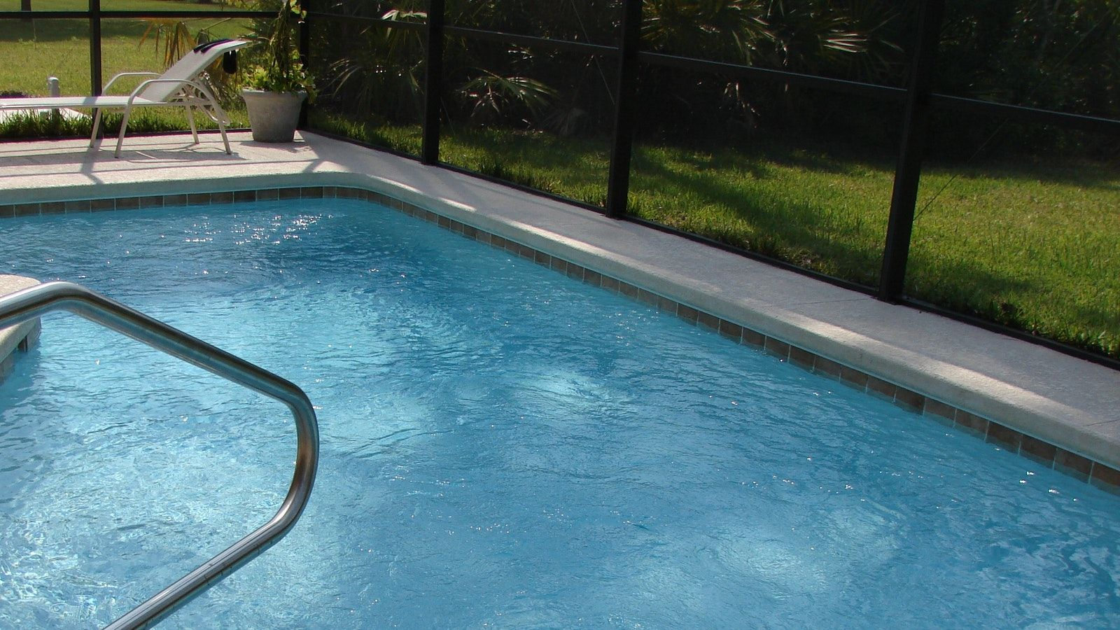 Swimming pool next to pool fence banner image