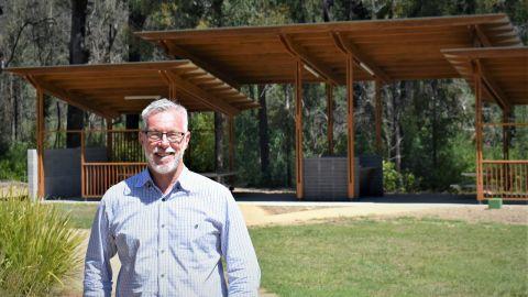 Michael Anlezark standing in front of wooden structure